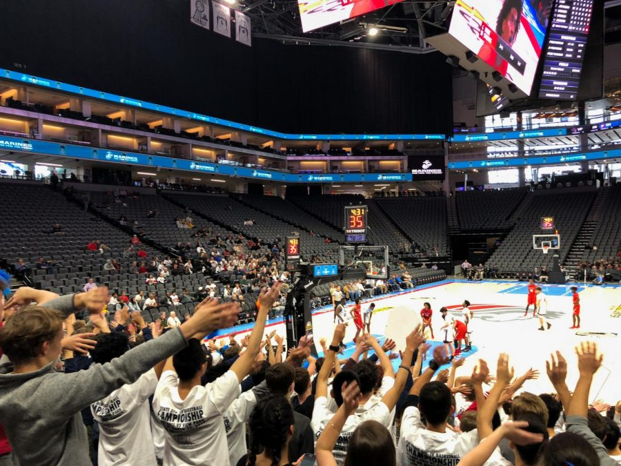 "Crowd members raise their hands to try and distract the opposing team while they shoot free throws. While Stuart Hall players took free throw shots, the crowd held out their hands and wiggled their fingers sending ""good vibes"" to the team."