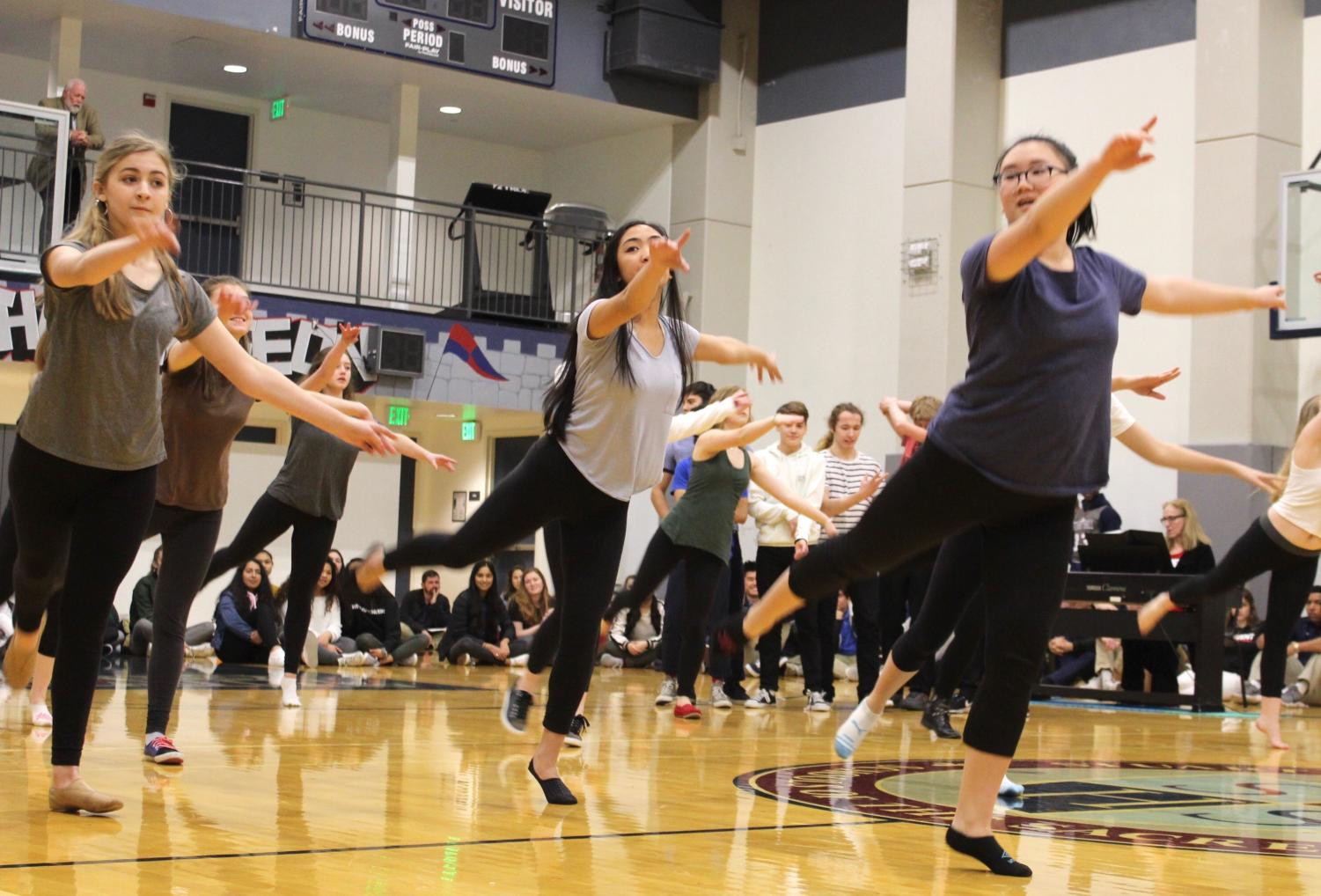 Freshman Grace Krumplitsch and juniors Bianca Mercado and Tommie Akamine perform the opening dance of