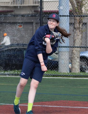 Freshman Cecilia McQuaid throws during practice with the Stuart Hall High School varsity baseball team. The team's next game is Tuesday, March 27 against  the Archbishop Riordan High School Crusaders.