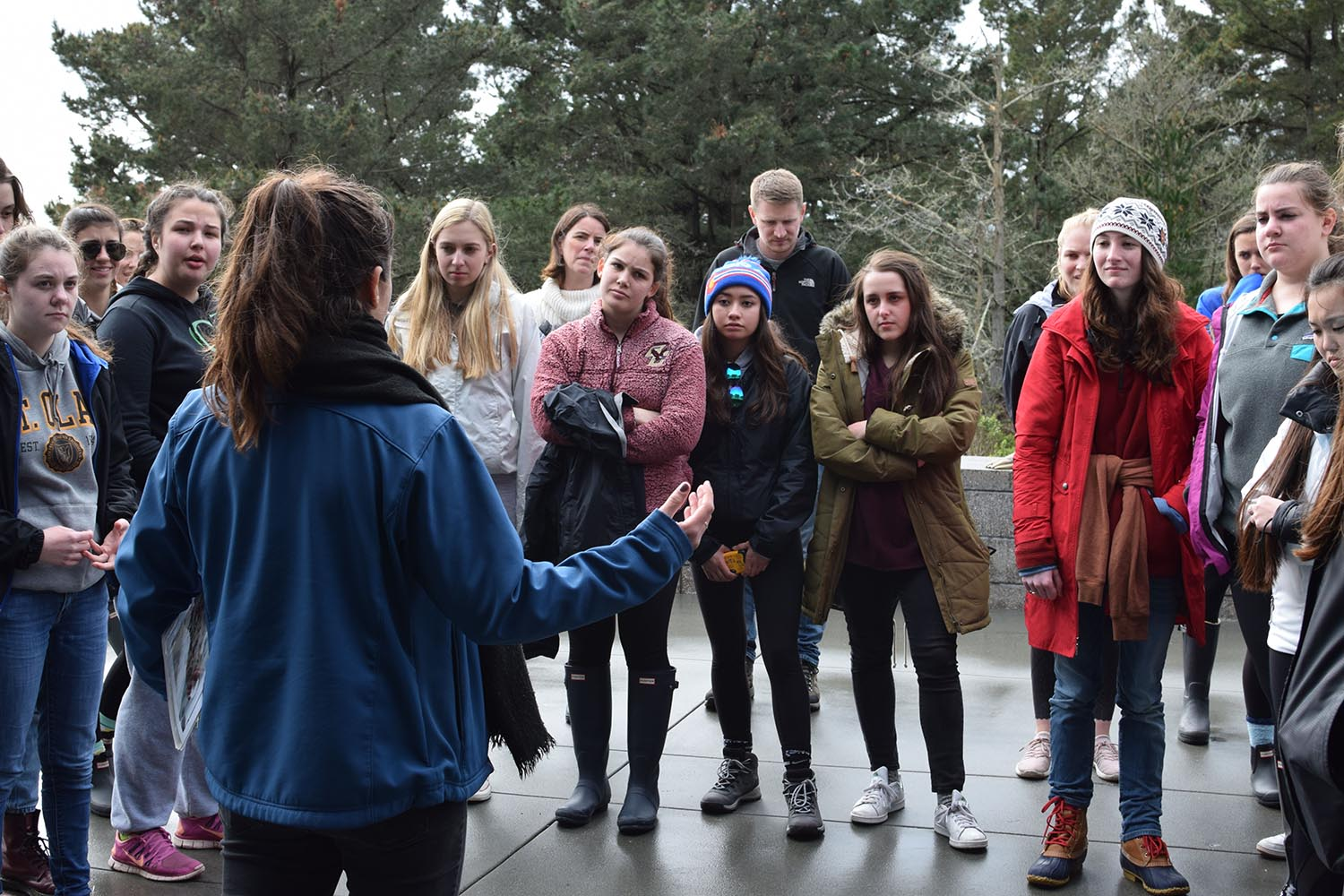 Seniors on retreat listen to an introduction about the Marine Mammal Center in Sausalito before going to observe the animals. The class stayed up past 11 p.m. for a circle sharing activity later that night.