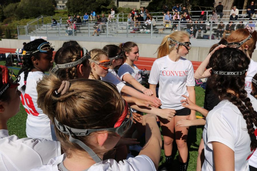 The+lacrosse+team+huddled+up+before+the+first+half+of+the+game.+Convent+won+against+Bay+High+School+with+a+final+score+of+11-9.