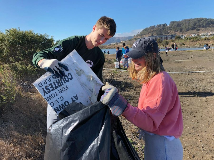 Seniors+Rachel+Cramer+and+Nick+Harle+pick+up+trash+from+the+beach+at+the+annual+California+Costal+Cleanup.+This+year%27s+cleanup+fell+on+the+Sacred+Heart+annual+Global+Service+Day.+