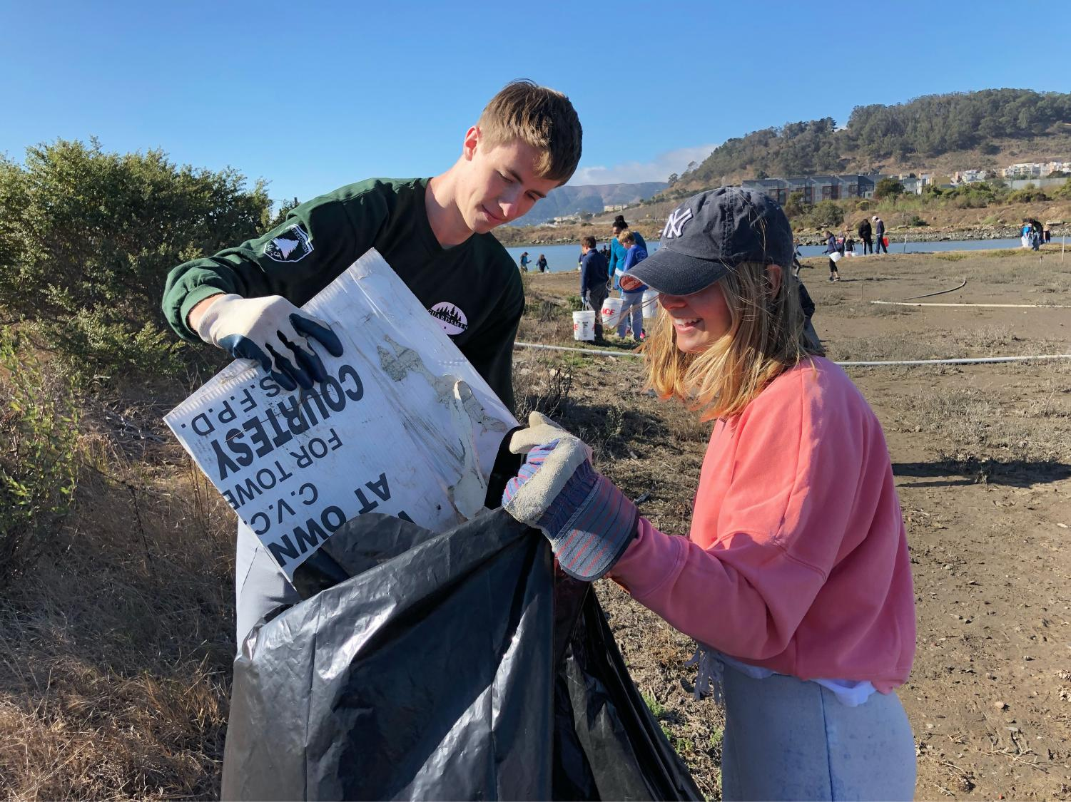 Seniors Rachel Cramer and Nick Harle pick up trash from the beach at the annual California Costal Cleanup. This year's cleanup fell on the Sacred Heart annual Global Service Day.