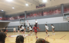 Varsity volleyball team wins game, ties for first in league