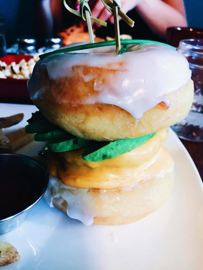 With donuts as buns, Straw recreates the classic hamburger. Straw has been open since 2011, but as of Sept. 17, Straw is only open for brunch.