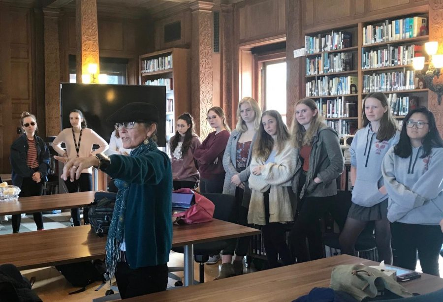 Theology teacher Kathryn McMichael gives instructions for an icebreaker activity. Students were asked to introduce themselves with  their name and a food that starts with the first letter of their name.