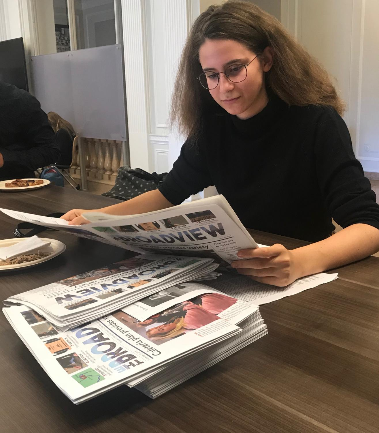 Junior Arlena Jackson reads the latest edition of The Broadview during National Newspaper Week. This week celebrates the service newspapers provide to the nation.