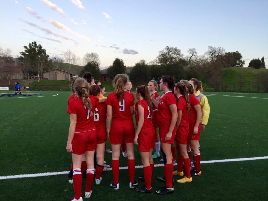 The+soccer+team+huddles+before+a+game+last+year.+The+season+has+been+moved+from+spring+to+winter.+