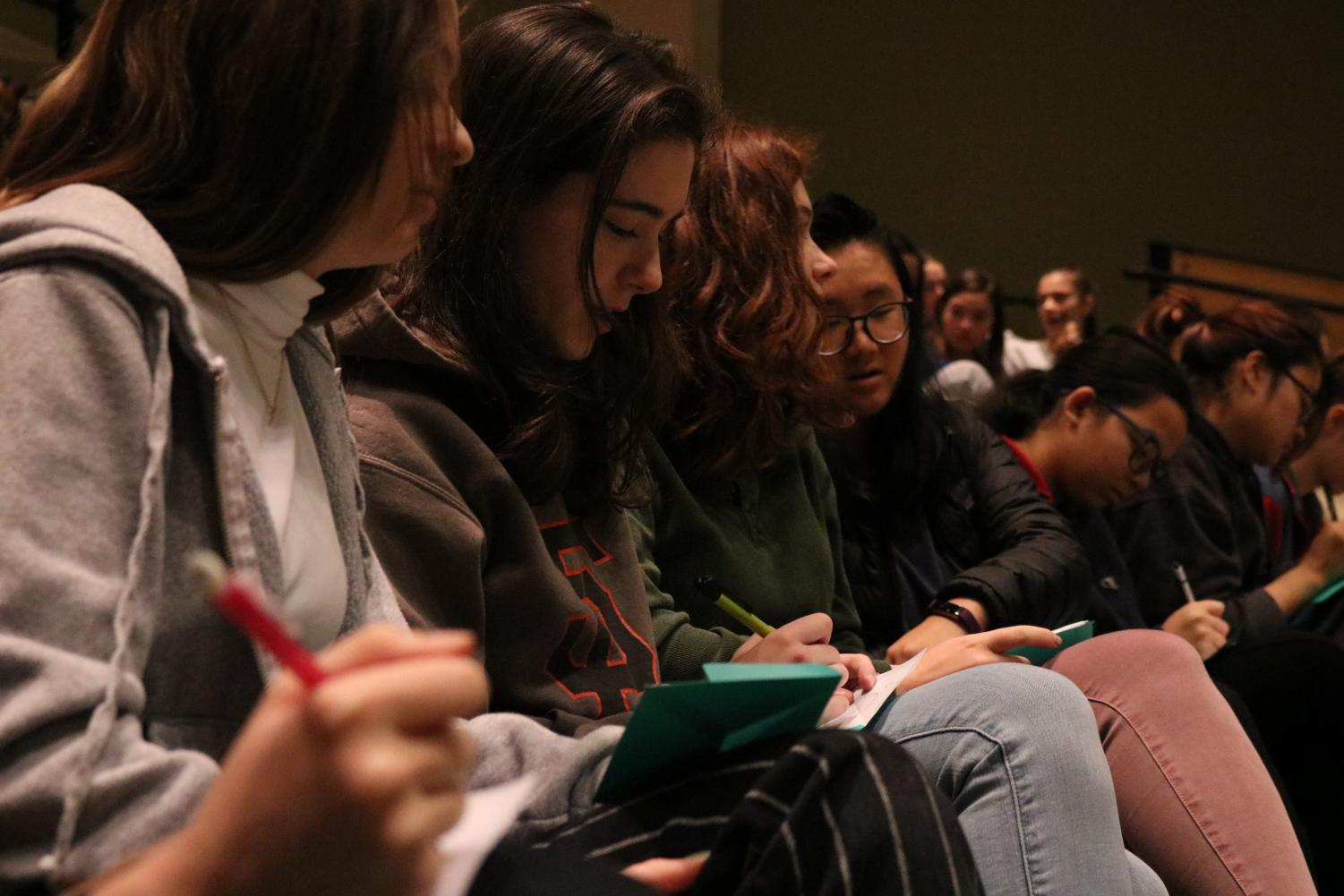 Seniors write notes of encouragement to a friend in need during a BC2M assembly. The club had students either keep the notes or give them to the friend.