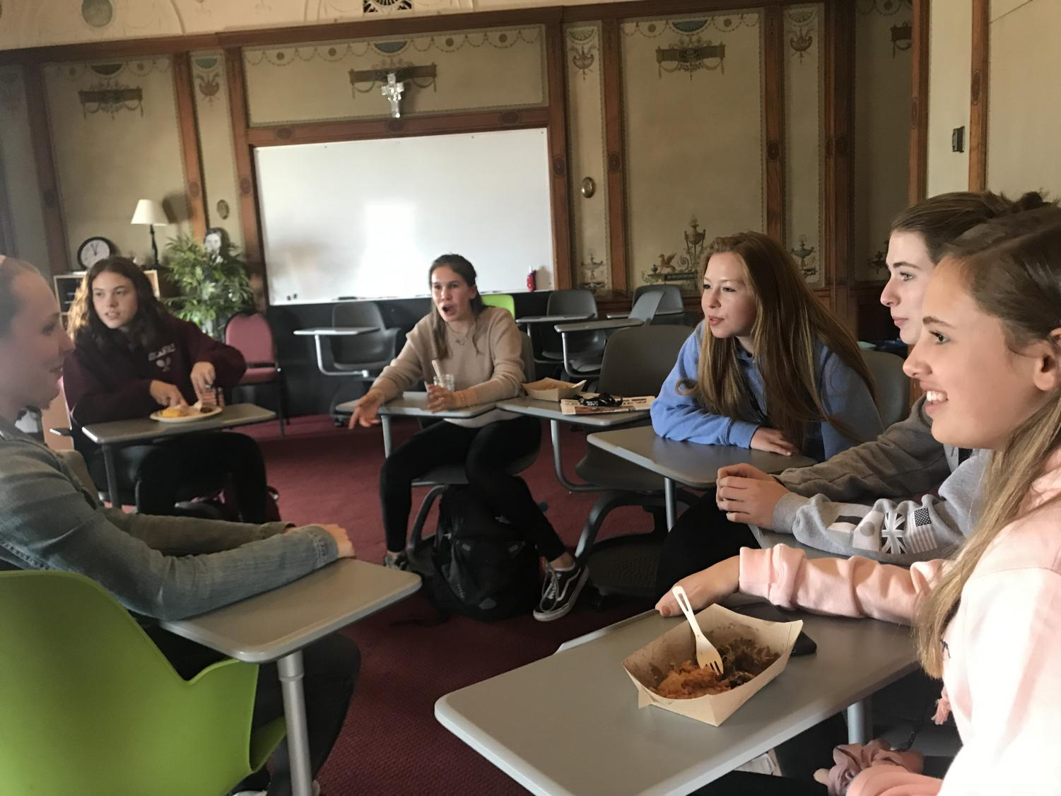 Members of the Wellness Wisdom Club discuss their goals for this year. The club, led by senior Worth Taylor, will meet every other Monday during lunch.