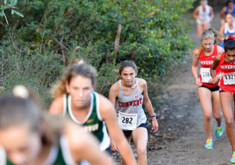 Sophomore Dagny Wallace runs up the hill at the Artichoke Invitational on Oct. 6. The cross-country team has competed in five invitationals and two league meets so far this season.
