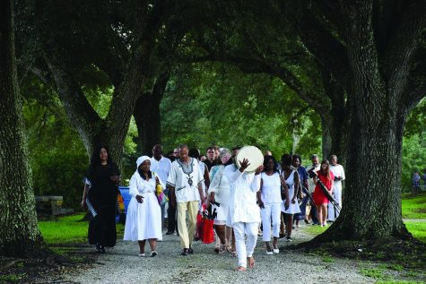 Descendants of people enslaved by the Society of the Sacred Heart after coming to North America walk with friends and family from St. Charles Borromeo Church in Grand Coteau, Louisiana to a nearby cemetery where a new monument honoring those enslaved stands. Brother Frank Authello Andrus, Jr. led the procession with drumming