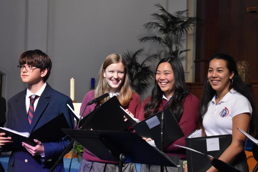 SING+OUT+The+high+school+co-ed+choir+leads+the+school+in+the+closing+song%2C+%E2%80%9CBlessed+Be+Your+Name.%22+Students+have+been+rehearsing+the+liturgy+songs+in+the+weeks+leading+up+to+the+service.+