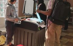 High school students volunteer at polls