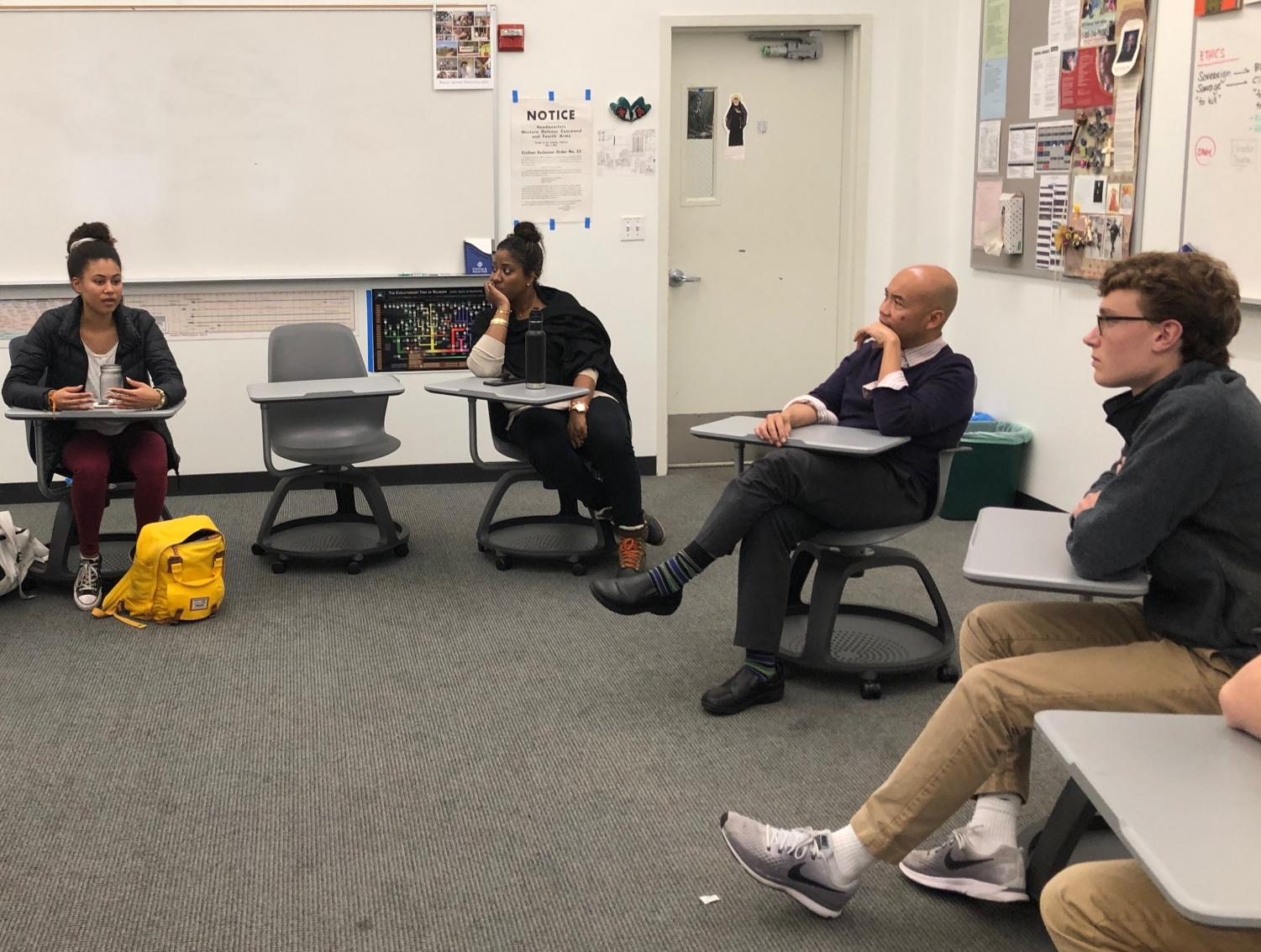 Junior Maxi Tellini, Ethics Teacher Michael Campos and People of Color Student Union advisor Allyson Maebert listen to junior Ryann Minnis during a Collab meeting. Students had previously expressed interest in making a safe coed space to discuss  race and ethnicity.