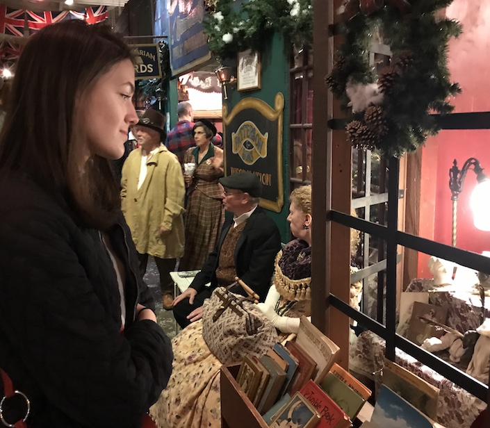 FESTIVITIES Sophomore Halsey Williamson looks into a bookshop window at The Great Dickens Christmas Fair. The fair has dozens of antique and gift shops to visit.