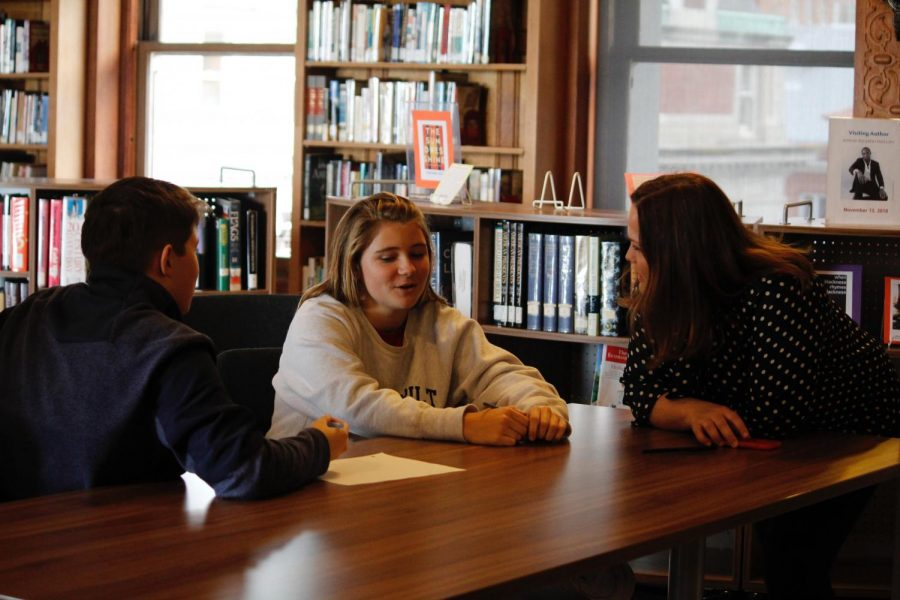 """Freshmen Avery Stout and James O'Leery talk with Ninth Grade Chair Sarah Garlinghouse about their assignment for the second half of """"Freshman Success"""". The day began with group discussions and ended with coed jobs to help out faculty."""