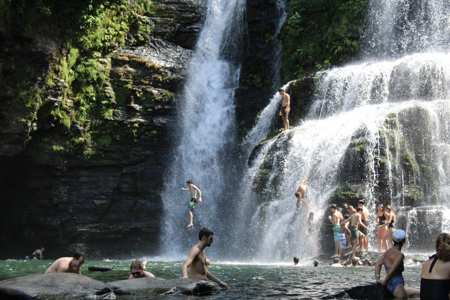 Students from the class of 2019 jump off the waterfall after a day of hiking and horseback riding in Costa Rica. Current sophomores plan to partake in similar adventures next week including ziplining, service activities, and horseback riding.