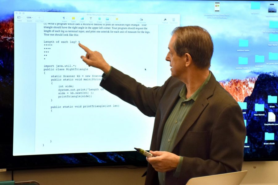 IF, THEN Computer science teacher Doug Grant shows the senior IB Computer Science class how to write recursive code in Java. The school recently awarded Grant the Niehaus Family President's Excellence Award and honored him as the namesake for an endowed Chair of Computer Science.