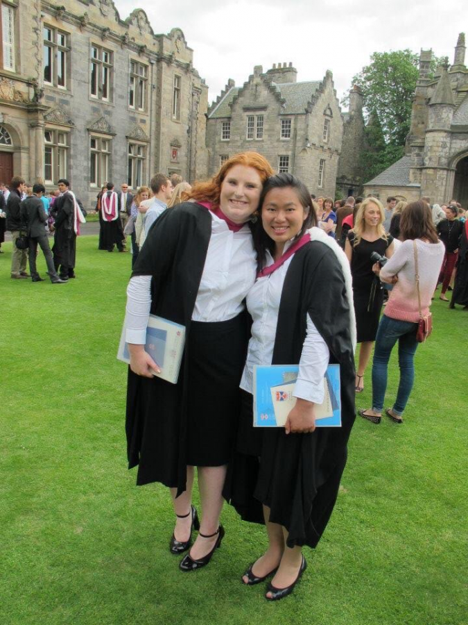 STUDYING+ABROAD+Jocelyn+Friday+%28%E2%80%9909%29%2C+left%2C+and+a+classmate+hold+up+numbers+to+represent+their+2013+graduation+from+the+University+of+St+Andrews.+After+majoring+in+computer+sciences+and+mathematics+and+earning+her+BSc+at+University+of+St+Andrews%2C+Friday+earned+her+MSc+from+the+University+of+Edinburgh.+