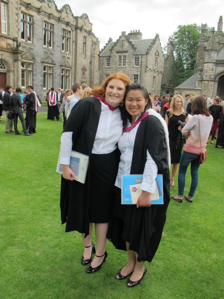STUDYING ABROAD Jocelyn Friday ('09), left, and a classmate hold up numbers to represent their 2013 graduation from the University of St Andrews. After majoring in computer sciences and mathematics and earning her BSc at University of St Andrews, Friday earned her MSc from the University of Edinburgh.