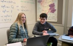 French exchange student Jules His helps freshman Maddie Drda on her French assignment. His is visiting Convent & Stuart Hall for the next two weeks.