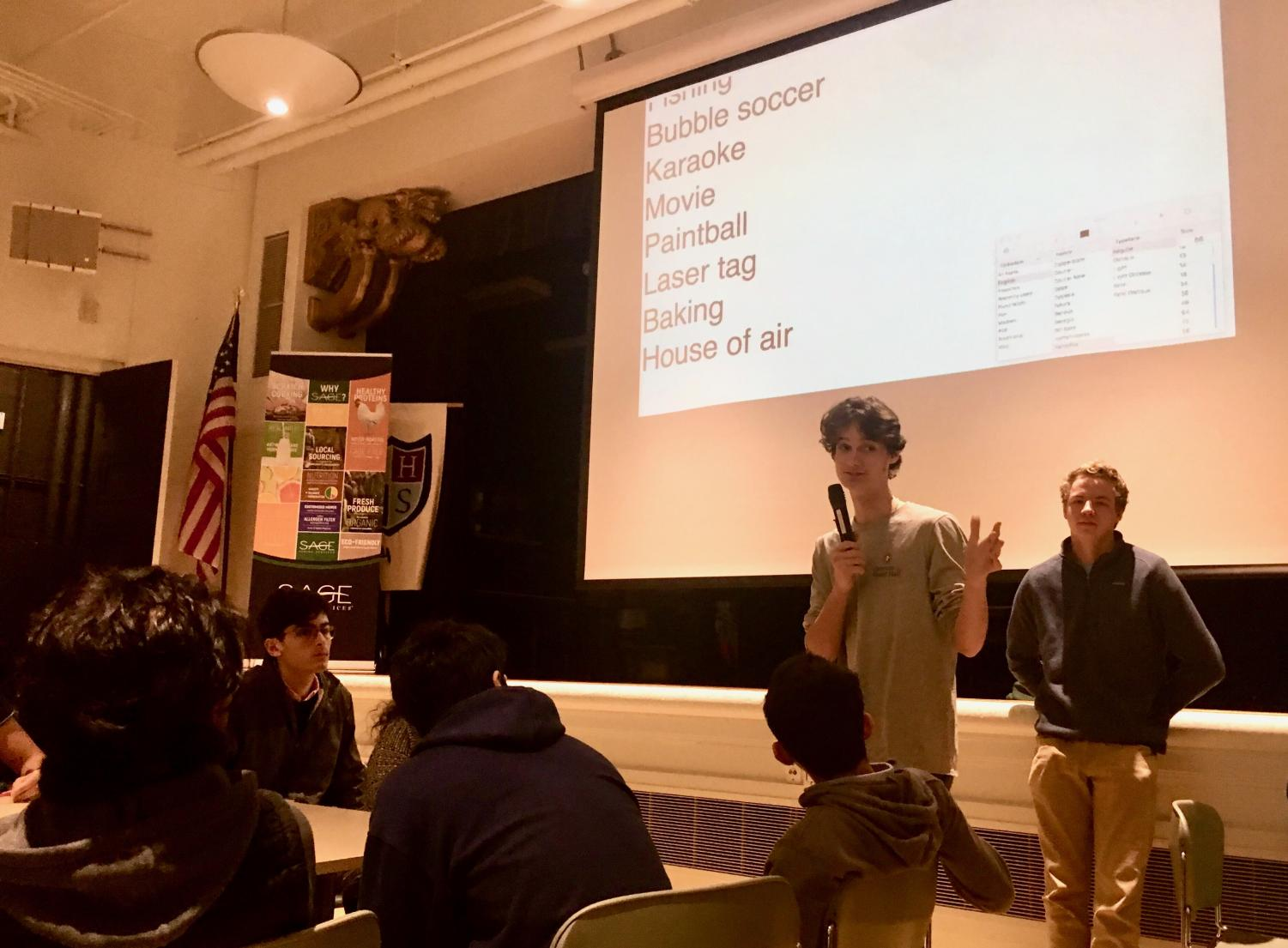 Stuart Hall junior Ryan Darwin asks the junior class for suggestions in planning a co-ed social event. Table groups came up with ideas such as going to House of Air or playing hide-and-seek at the Broadway campus.