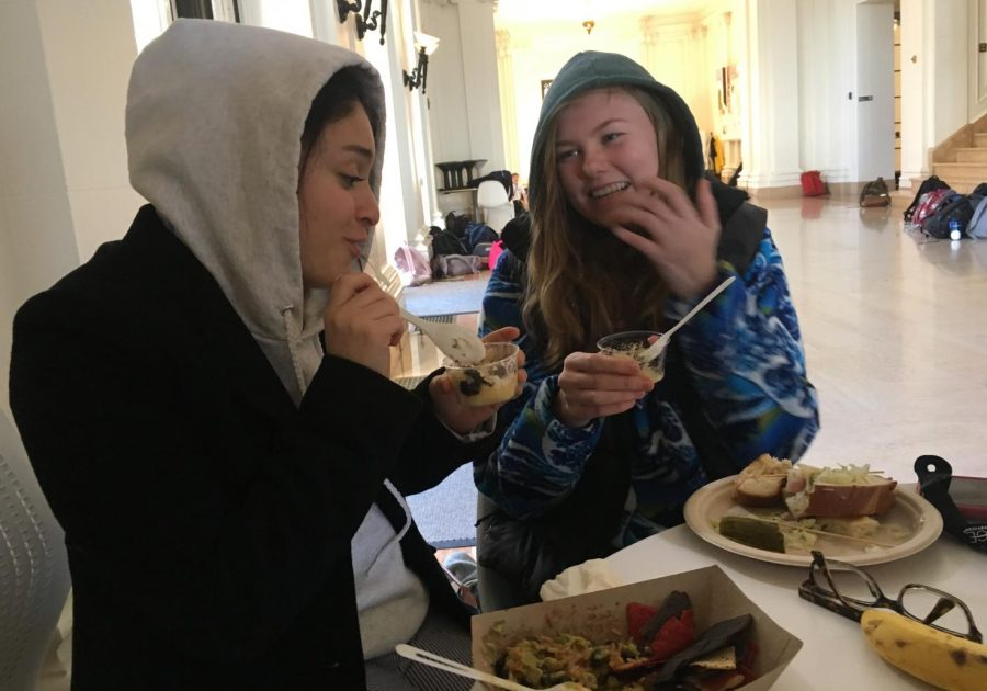 Seniors Isabella Bermejo and Molly Brown eat lunch in the main hall while wearing multiple layers. Temperatures in San Francisco averaged around low 40s this week and even lead to snow on high peaks around the Bay Area.