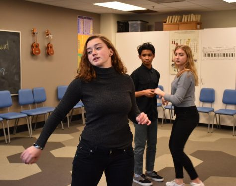 "Choreographer Delaney Tobin rehearses numbers with the musical cast for the spring show of ""Love's Labour's Lost"" that ran last week. Tobin choreographed over 15 numbers for the show."