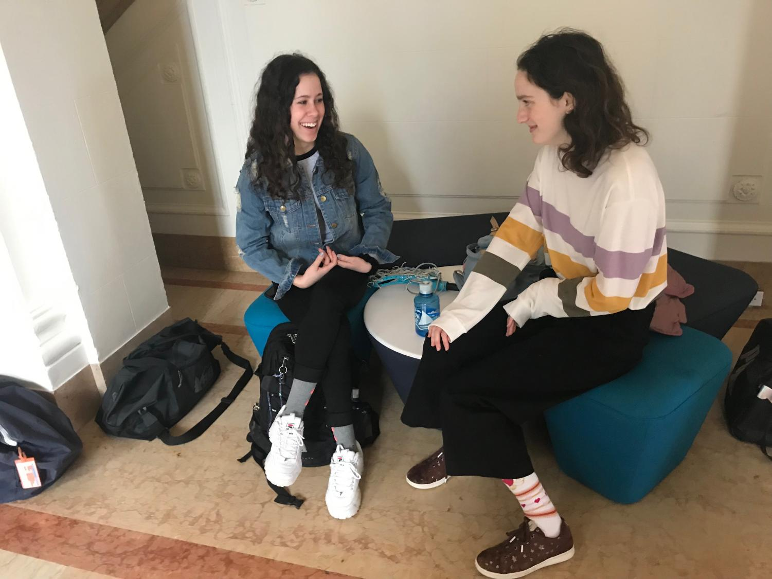 Sophomores Emily LeBlanc, who is visiting from the Academy of the Sacred Heart in New Orleans, and Audrey Scott, her host, talk in the main hall before class. Scott went to New Orleans in February and attended Academy of the Sacred Heart for a week with LeBlanc.