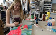 Freshman Madeline Drda paints a giraffe for her spirit animal art project. The class used the project as a way to practice color theory.