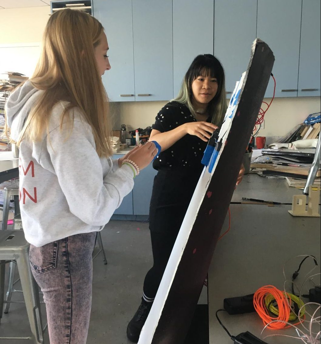 Art teacher Malisa Suchanya helps sophomore Kati Walter with her public art project. Sophomores in Art Foundations II installed art projects around the Broadway campus which will be on display through the end of the school year.