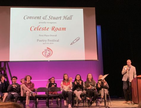 Guest Speaker David Nyquist announces the Convent High School Poetry competition winner, Celeste Roam. Winners were told to stand so they could be recognized by their peers.