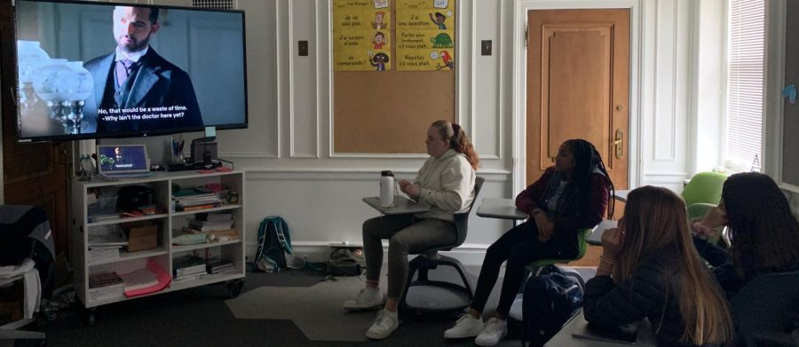 "Girls in Rebecca Jenkinson's Spanish II class watch the telenovela series called the ""Grand Hotel."" The Spanish program offers subtitles to improve the students comprehension of the language."