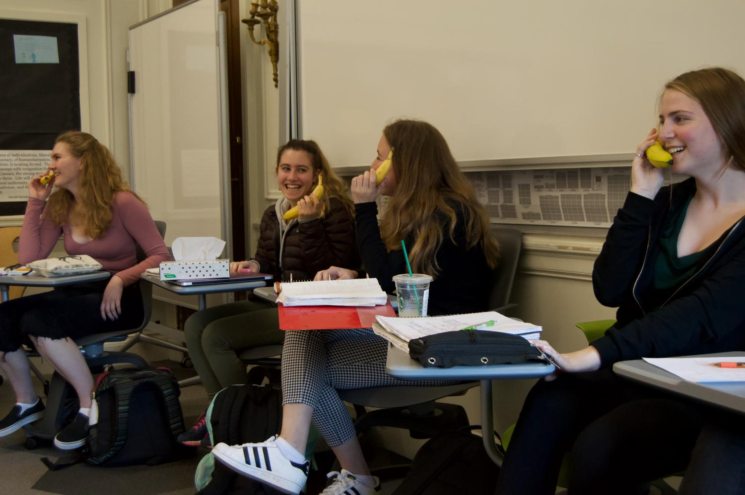 Sophomores 'speak' into their banana 'phones' as part of a prank on History teacher Michael Stafford organized by English teacher Angelica Allen. The students obtained their bananas before class began to be prepared for the prank.