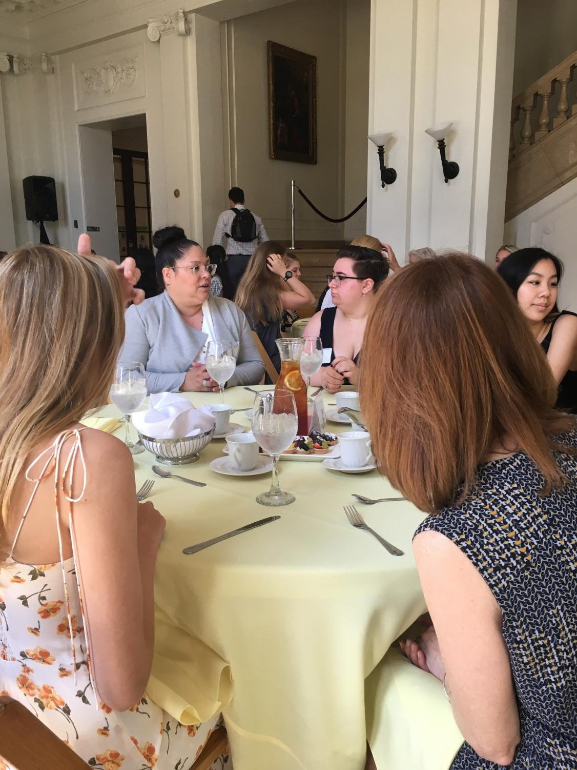 Seniors and members of the Sacred Heart alumnae network talk among themselves at the Alumnae Luncheon. During the luncheon, seniors were given sweets and gifts to welcome them into the network.