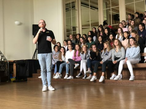 Chair of Community Life Paul Pryor Lorentz addresses the student body during the assembly in the Little Theater. The administration organized the assembly to discuss the necessity of following rules outlined in the handbook.