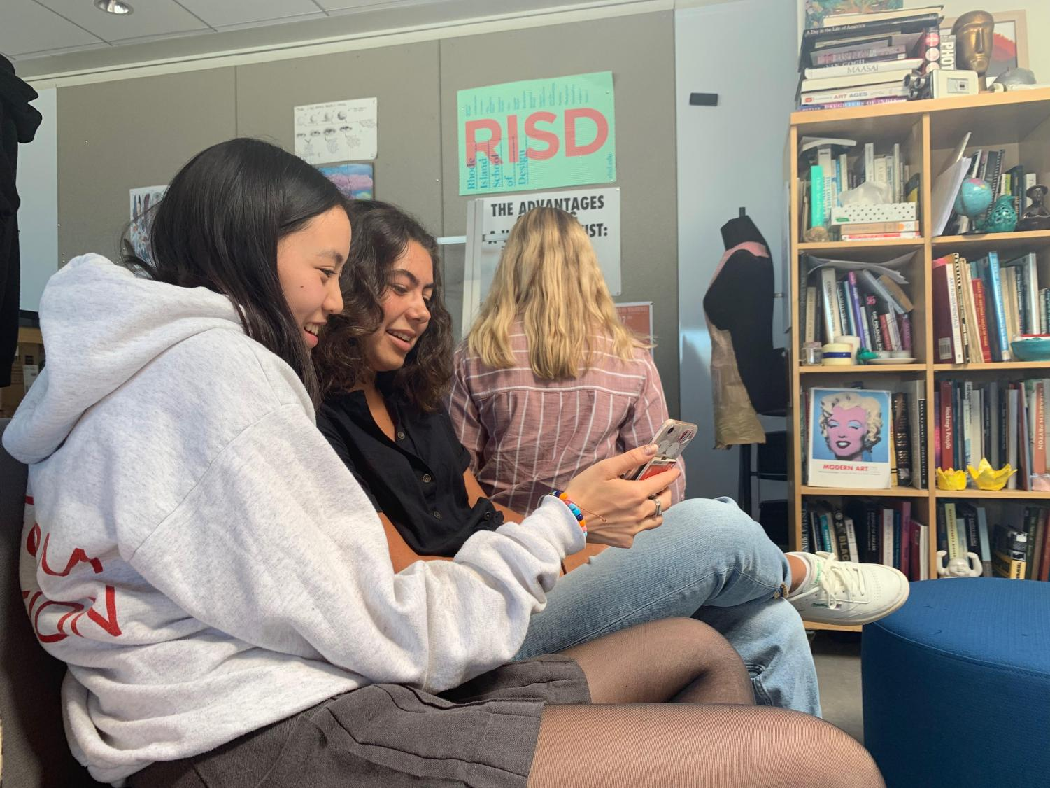 Juniors Madi Lerseth and Sofia Houts review the daily schedule online during a PAWS meeting. Students met with their advisories for the first time this year.