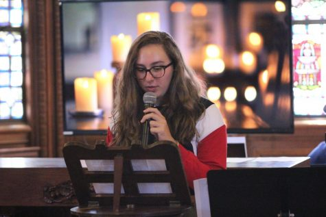 Junior Lili Levy reads a quote from St. Madeline Sophie Barat at the first chapel of the year.