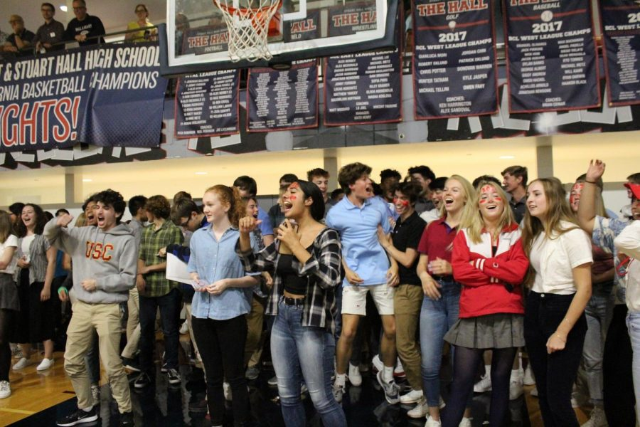 Seniors cheer for their representatives in the relay race. The pep rally, led by the Student Council, included many school spirited games and activities.