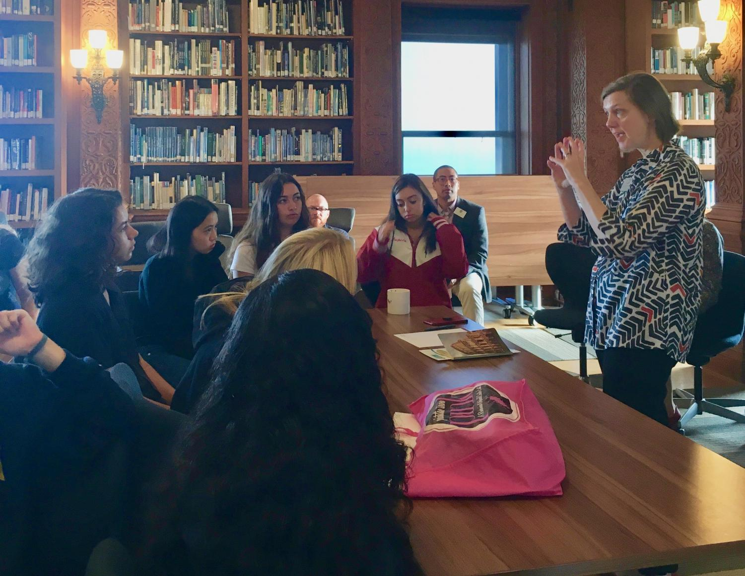 Head of School Rachel Simpson addresses juniors about the importance of CAS. The meeting was held over two days to accommodate the differences in students' location of their A period class.