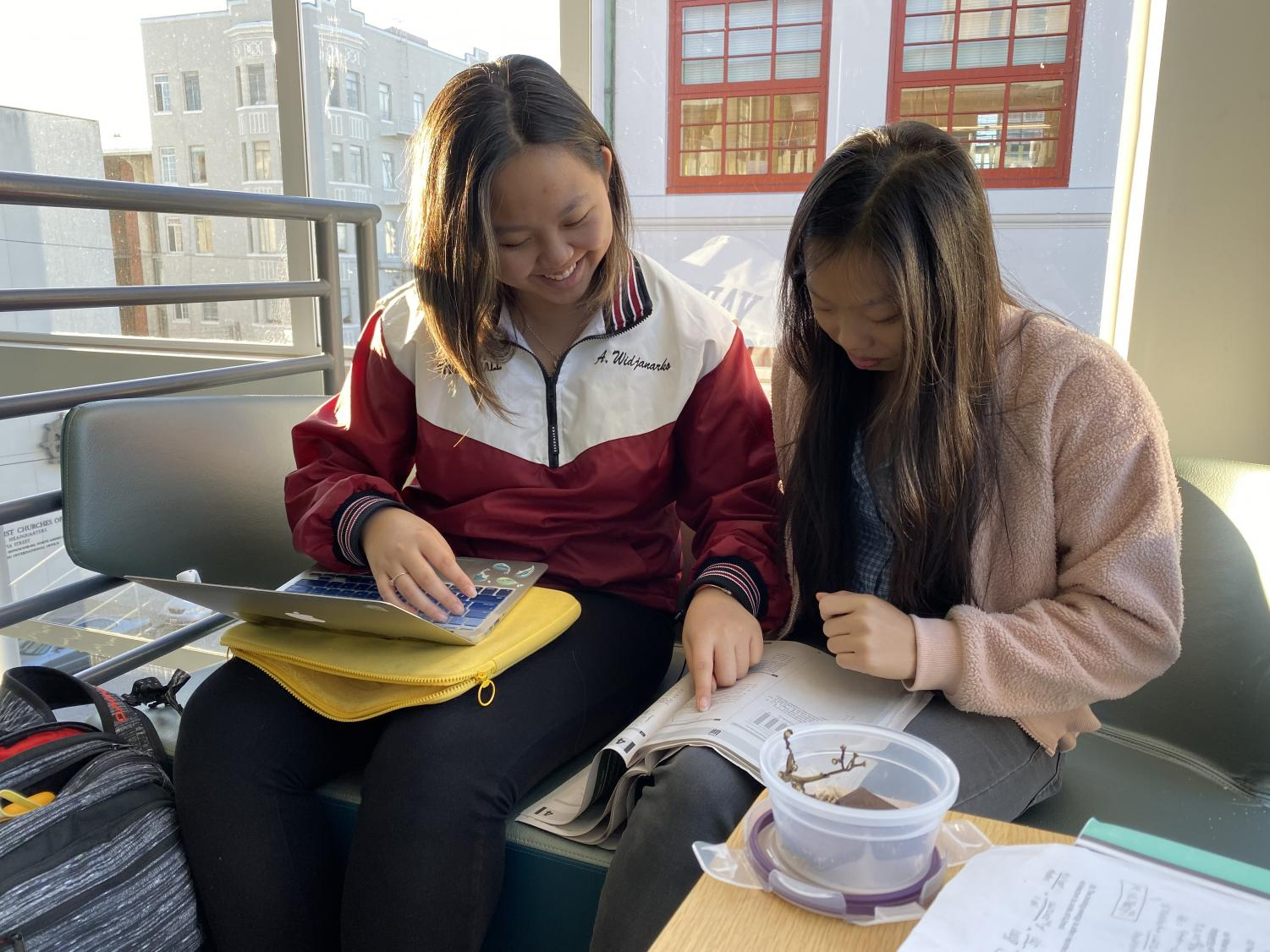 Senior Abby Widjanarko helps sophomore Madison Kwan study for the PSAT. Freshmen, sophomores and juniors will take the exam on Oct. 16.