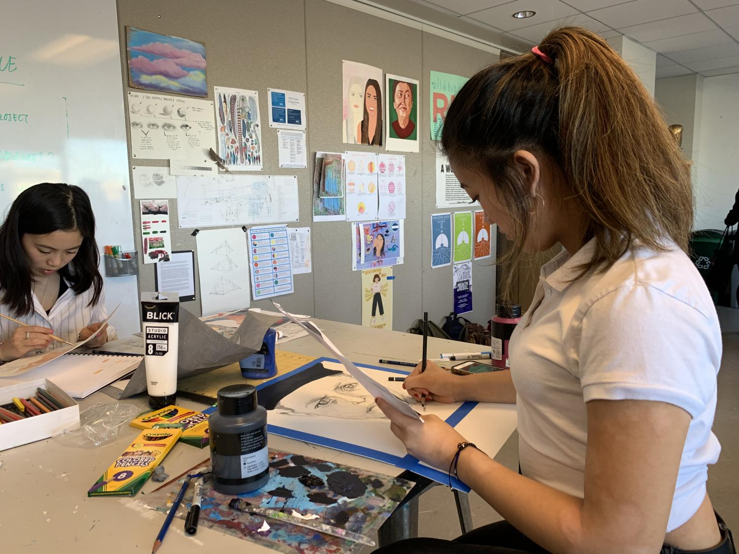 Junior Nina Sanchez uses pencil to sketch her portrait of a young boy in Pakistan. IB Visual Art students will send their finished works to the children in Nov.