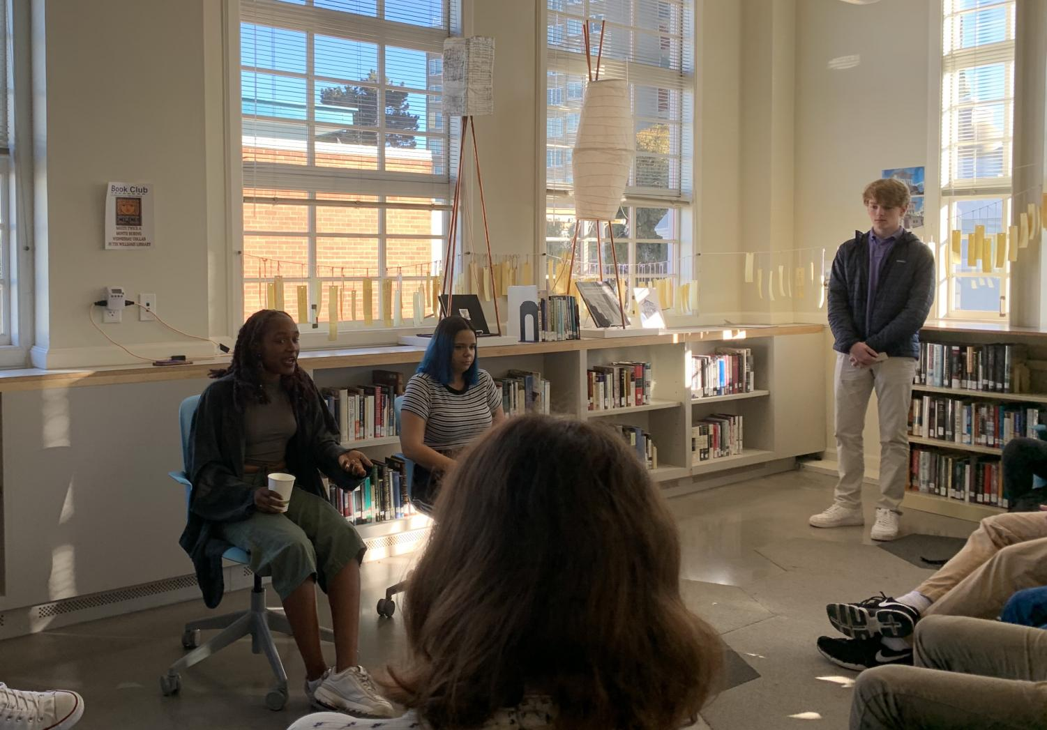 Guest speakers Bria Smith and Samantha Fuentes speak to a group of students in the Carroll Learning Commons. The event was organized by junior Cole Matthes.