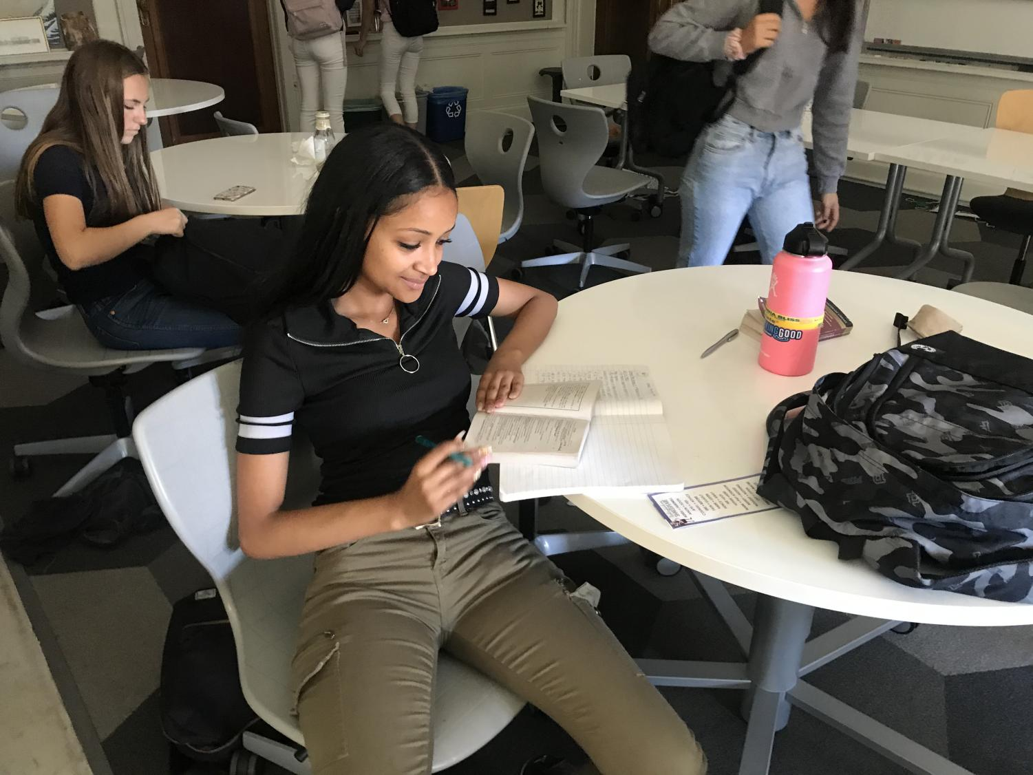 Sophomore Beza Geberesilassie reads over her annotations in her Othello book during class. Students use their annotations as a basis for discussion on the reading that was assigned for a particular class.