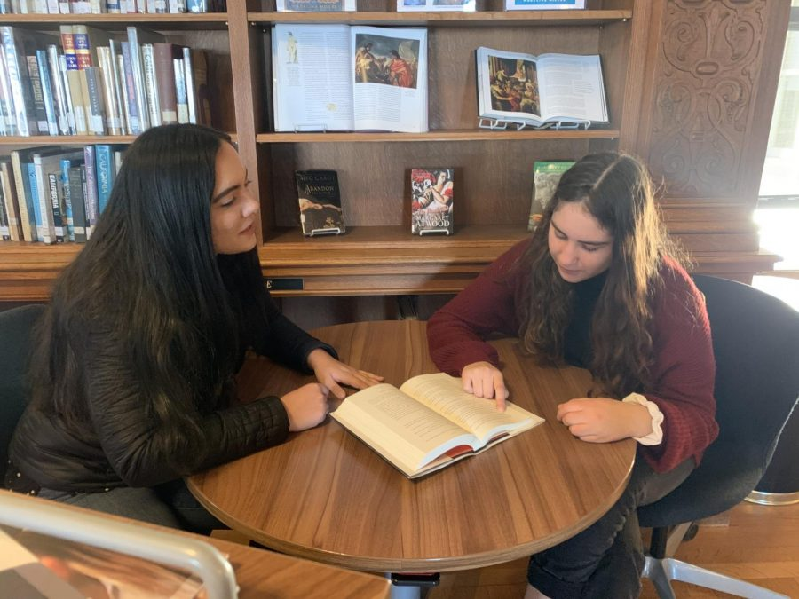 Book club co-head Grace O'Reilly discusses 'Circe' with book club member Estie Seligman. The club meets weekly and is reading the book in anticipation of Madeline Miller's visit on Nov. 19.