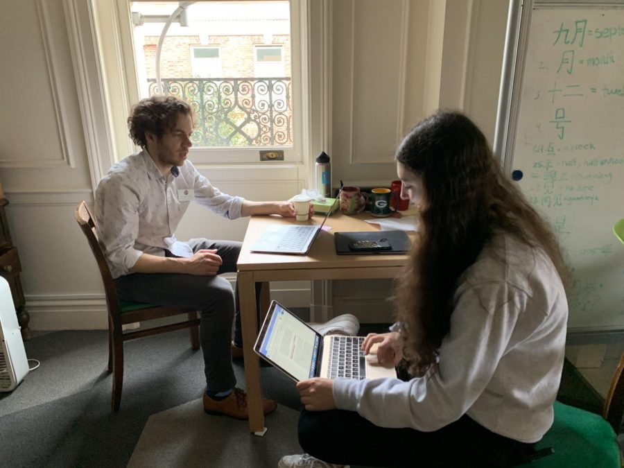 Sophomore Skylar Goldberg works with theology teacher Bryan Lorentz on her final project. Students were assigned to create a short podcast with a reading and interpretation of different scriptures.