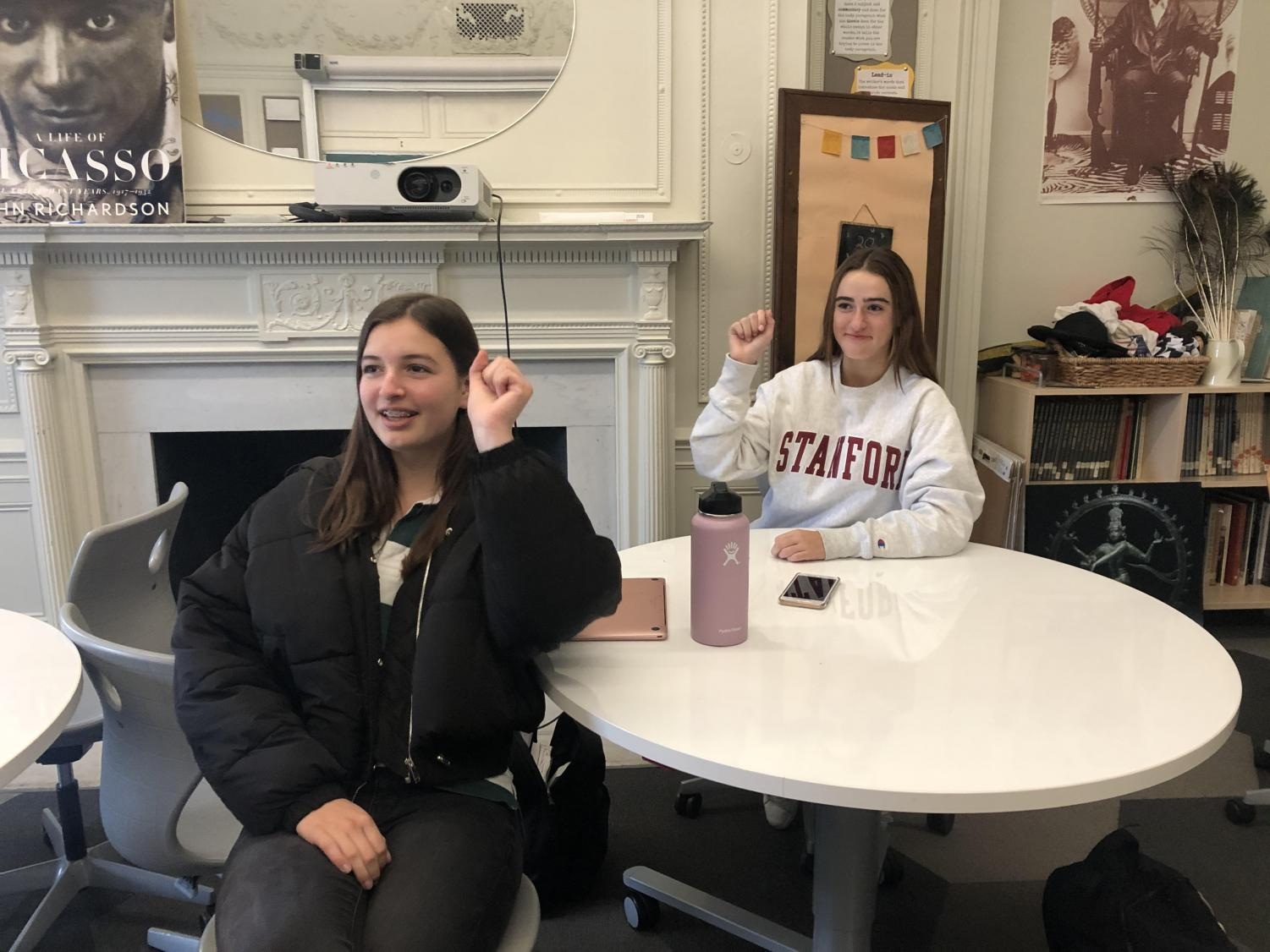 "Spanish III students Cristina Jackson and Olivia Williams practice their hand motions and Spanish song for Noels. Their class's song is called ""Tun Tun"" and is about Christmas carolers knocking on doors around Christmas time."