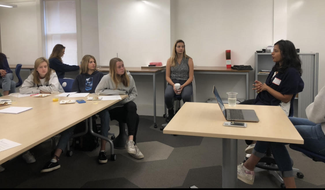 Female Leaders in Technology club members listen to software executive Natasha Mohunty present on the Broadway Campus about opportunities for women in the STEM field. The presentation was the first of a planned series.