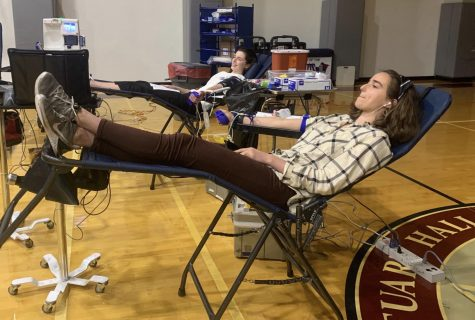 Juniors Kate Baker and Isabel Hoppmann give blood. Donating blood can save up to three lives.